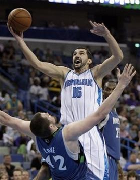 New Orleans Hornets forward Peja Stojakovic, from Serbia, is called for a charge foul as he collides with Minnesota Timberwolves forward Kevin Love in the second half of an NBA basketball game in New Orleans on Sunday, Feb. 8, 2009. THe Hornets won 101-97.